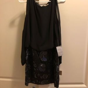 Beautiful black and sequin dress with long sleeves